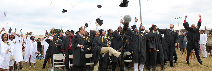 Groups of Students throwing graduation caps into the air